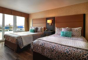 A bed or beds in a room at The Lonsdale Quay Hotel