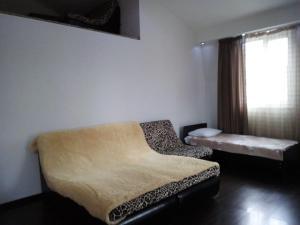 Кровать или кровати в номере Apartment Poltavskaya 14