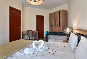 Кровать или кровати в номере Apart Hotel Golden Line