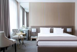 Кровать или кровати в номере Бутик-отель «1852»