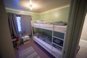 En eller flere køyesenger på et rom på Ellingsen Apartment - Kong Hans gt 6