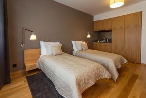 A bed or beds in a room at Vinařství Obelisk