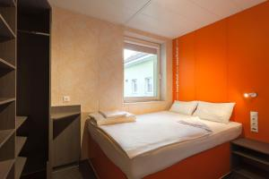 A bed or beds in a room at easyHotel Budapest Oktogon