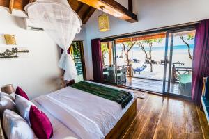 A bed or beds in a room at Sol Beach Resort
