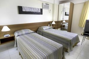 A bed or beds in a room at Littoral Maximum Flat