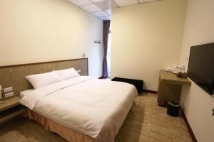 ChangJu Hotelにあるベッド