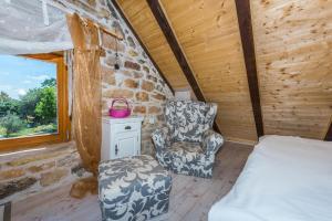 "A seating area at Rural house Mudrinic ""Ivini dvori"""