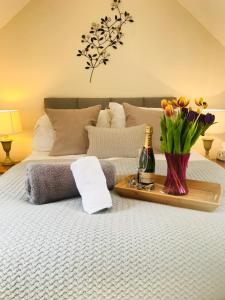 A bed or beds in a room at The Celyn