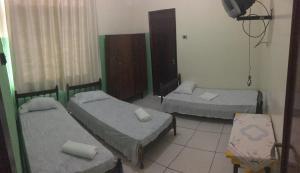 A bed or beds in a room at Hotel 9 de Julho