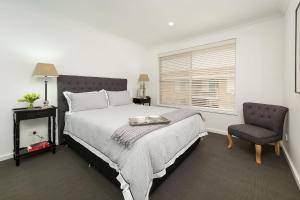 A bed or beds in a room at The Provincial - Central & Sophisticated