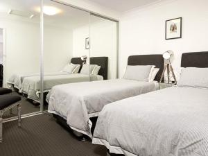 A bed or beds in a room at New York Dreamer - Central & Sophisticated