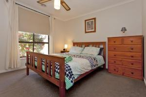 A bed or beds in a room at Serenity, Size, and Seclusion