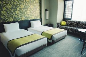 A bed or beds in a room at Oriental Hotel