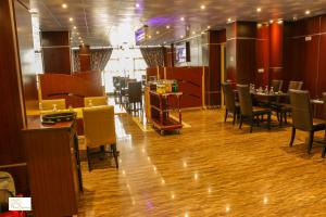 A restaurant or other place to eat at Noubou International Hotel