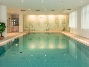 The swimming pool at or near Hotel Am Moosfeld