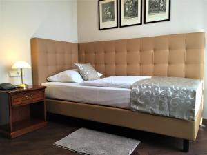 Ein Bett oder Betten in einem Zimmer der Unterkunft Villa Knobelsdorff