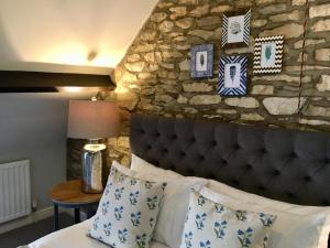 A bed or beds in a room at The Sheep on Sheep Street Hotel