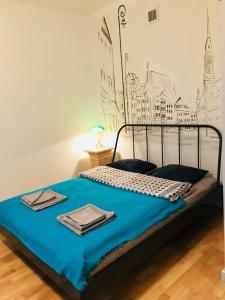 Łóżko lub łóżka w pokoju w obiekcie Apartment in Heart of Old Town