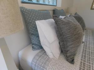 A bed or beds in a room at Beachport Bed & Breakfast