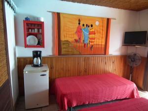 Un ou plusieurs lits dans un hébergement de l'établissement Le Cardinal des Grands Bleus