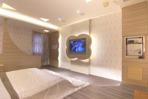 A television and/or entertainment center at Shihua Motel