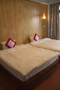 A bed or beds in a room at The Barfung Retreat