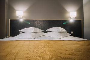 Voodi või voodid majutusasutuse Centrum Hotel Viljandi toas