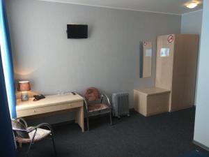 Кровать или кровати в номере Alex Hotel