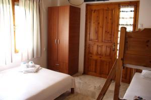 Ένα ή περισσότερα κρεβάτια σε δωμάτιο στο Patroudis House