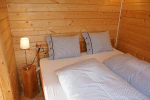 Ein Bett oder Betten in einem Zimmer der Unterkunft Villa Donkey Chalet