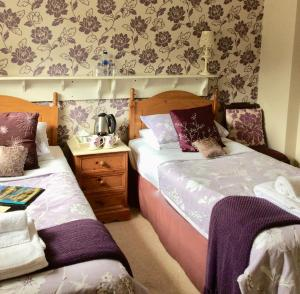 A bed or beds in a room at Plumpton Court