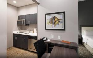 A kitchen or kitchenette at Homewood Suites By Hilton Topeka