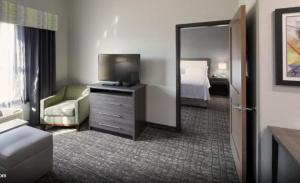 A television and/or entertainment center at Homewood Suites By Hilton Topeka