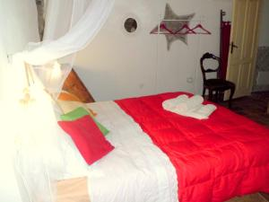 A bed or beds in a room at Appartamenti Storici al Mare
