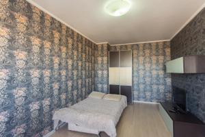 Кровать или кровати в номере BestFlat24 Rozhdestvenskaya 7