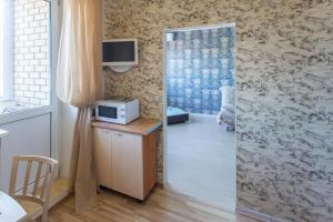 Телевизор и/или развлекательный центр в BestFlat24 Rozhdestvenskaya 7