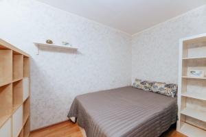 Кровать или кровати в номере Апартаменты метро Козья слобода ТРК Тандем
