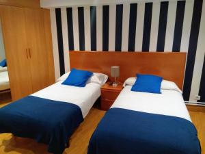 A bed or beds in a room at Aldatzeta Ostatua