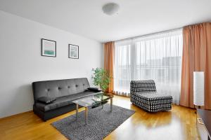 Ein Sitzbereich in der Unterkunft Apartment Prague Angel