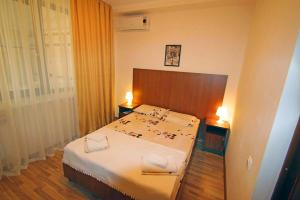 A bed or beds in a room at Guest House Demetra