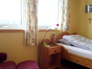 A bed or beds in a room at Holmely