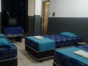 A bed or beds in a room at Hotel Prata