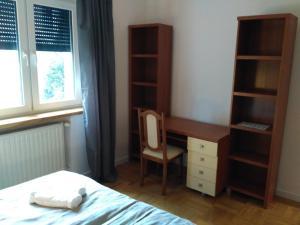 A bed or beds in a room at Apartament Legnicka 1