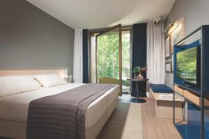 A bed or beds in a room at Parc Hotel Billia