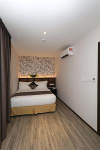 A bed or beds in a room at Double M Hotel @ Kl Sentral