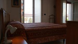 Letto o letti in una camera di Apartment Residence Acapulco