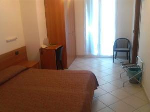 Кровать или кровати в номере Hotel Adriana