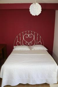A bed or beds in a room at Casa da Maisa