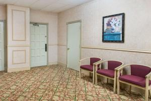 A seating area at Days Inn by Wyndham Branford New Haven Conference Center