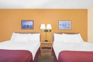 A bed or beds in a room at Days Inn by Wyndham Wall